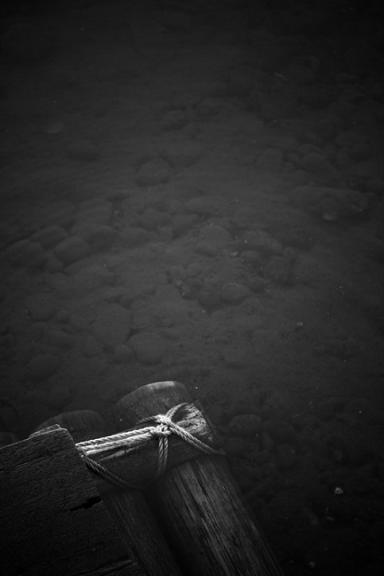 raft, dark water, shallow water, stones