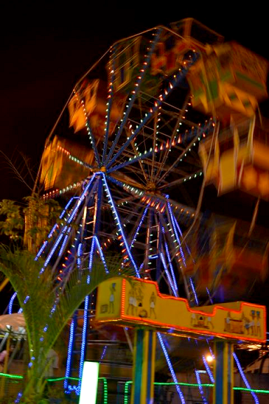ferris wheel, spinning round, moving too fast